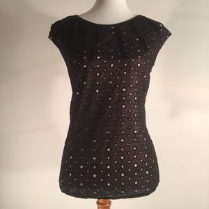 The limited Black with Tan Eyelets Sleeveless Top